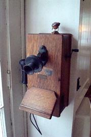 Antique oak wall telephone.