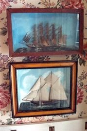 Half ships mounted in frames.