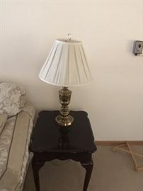 Nice end tables with unique lamps.