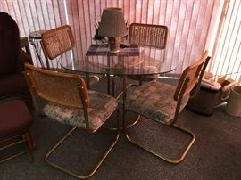 4 chairs wicker and cloth and glass table dinette set--$250.