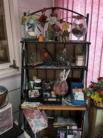 Bakers rack-  wrought iron with wood table. $65  (items on rack are sold separately).