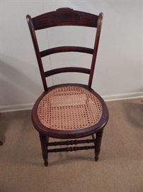 Cain Bottom Chair With Carved Etching on Back, Carved Front Legs