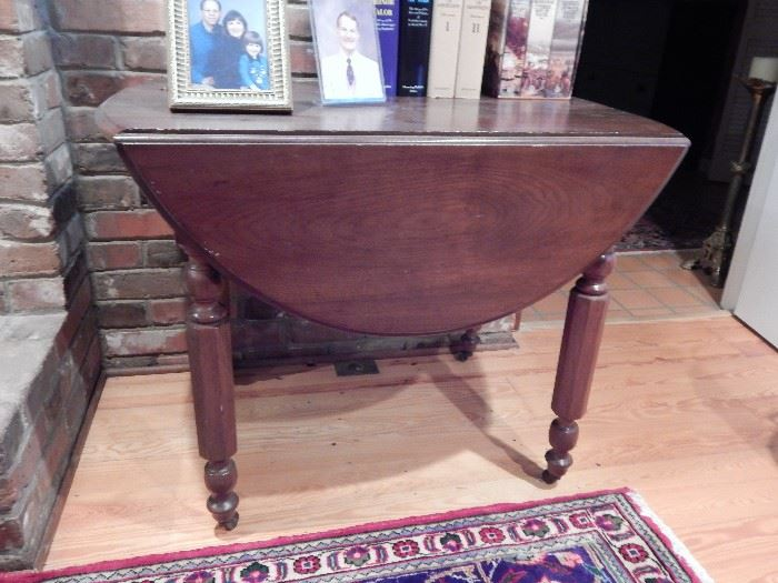 Drop Leaf Farm Table With Metal Rollers