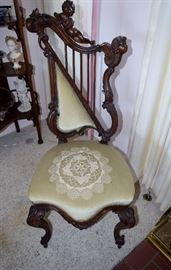 Unusual Victorian side chair with cherub heads and harp back