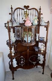Great Walnut Victorian fancy shelf with revolving glass door. With three LLardos inside.