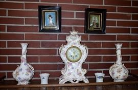 Mantel  clock and two vases . German