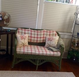 This vintage wicker love seat is sturdy and includes the custom cushions.