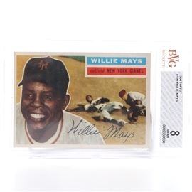 1956 Topps Willie Mays Card: A 1956 Topps Willie Mays card. This card was graded as an 8 by Beckett Grading Services and is marked as such on the hard plastic card sleeve.