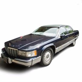 1993 Cadillac Fleetwood Brougham: A navy 1993 Cadillac Fleetwood Brougham full size, 4-door sedan; VIN is 1G6DW5279PR728514 and with 119,871 miles. Features include an automatic transmission; a 5.7 liter, 8 cylinder gasoline engine; gray leather upholstery; and power features including a heated driver's seat.