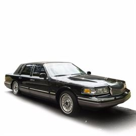 1995 Lincoln Towncar: A black 1994 Lincoln Towncar 4-door full-size sedan; VIN is 1LNLM82W2SY679853 and with 133,681 miles. Features include an automatic transmission; a 4.6 liter, 8 cylinder gasoline engine; a black leather interior with burl wood trim; and power seats, windows and locks.