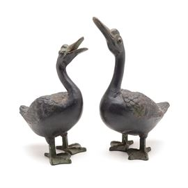 "Pair of Cast Iron Duck Sculptures: A pair of circa mid-20th century vintage cast iron sculptures of ducks. Marked ""Japan"" to the underside of the feet."