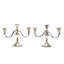 """Weighted Sterling Candelabra by Preisner: A pair of Preisner weighted sterling silver candelabra. The candelabra are fashioned in two pieces, having three candle cups to the top which threads onto a footed base. Marked """"Preisner Sterling Weighted 724"""" to the base. The sterling silver content is un-weighted due to reinforcing material content."""