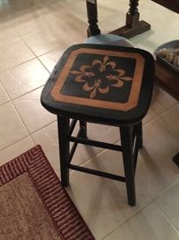 An illusion or fleur de lis??? Either way, it's a great little table for anywhere!