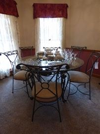 Wrought iron glass top table with 6 chairs