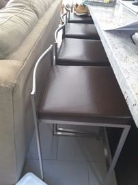 Short Metal Count Bar Stools with brown cushions. From Wayfair.