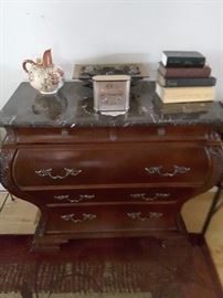 Vintage entry dresser, 3 drawers and 2 upper drawers, marble table top. This piece can be used for table linens and silverware in a formal dining room or front entry, hallway, bedroom, office area. Vintage Collectible Vase, Meditation Rocks, Clock, and Collectibles Books.