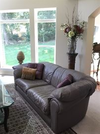 Designer, high quality leather sofa. Color is a contemporary slate/pale purple. Very good condition!