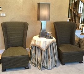 Designer side chairs by Hickory with custom upholstery; color is black/brown. Round side table with custom made cloth.