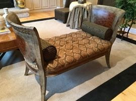 Designer exclusive settee with custom, tufted upholstery.