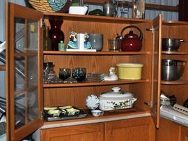 Kitchen sectional cabinets, serving pieces, pottery.