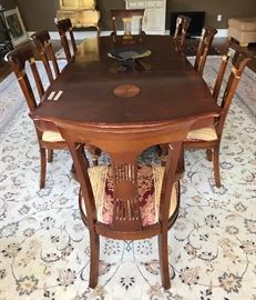 Large table with leaves and beautiful inlay. Ten chairs.