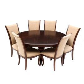 Six High-Back Chairs with Pedestal Table: A set of six high-backed side chairs, each having a mahogany finished frame with cabriole legs, upholstered in a beige textured fabric. Includes a matching pedestal table with one leaf.