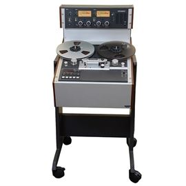 Studer Model A810 Studio Reel to Reel Tape Recorder: A Studer model A810 studio reel to reel tape recorder with rolling stand. The tape recorder features a microprocessor control system suited for studio applications, broadcasting, television and theater, having a rigid aluminum alloy chassis with a manually manipulatable head shield, electronically controlled tape tension and real-time tape timer. The editing feature offers four spooling speeds. Also includes a vinyl covered instruction manual.