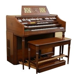 Wurlitzer Orbit III Synthesizer Organ: A Wurlitzer Orbit III Synthesizer organ with a walnut finish, three rows of keys with synthesizer, a built-in drum machine with presets including Waltz and Jazz Waltz, a built-in solid state Bell & Howell cassette recorder, multiple foot pedals and much more.