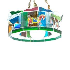 Vintage Carousel Stained Glass Hanging Lamp: A vintage carousel-motif stained glass hanging lamp. This piece features a multi-layered open-work design in vibrant greens, blues, reds, yellows, and oranges. It is not visibly marked.