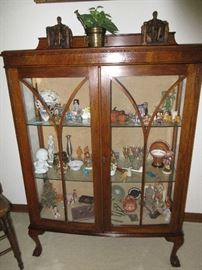 Antique cabinet fill with treasures from around the world