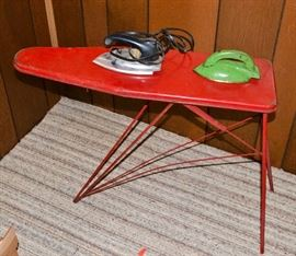 Antique ironing board and irons