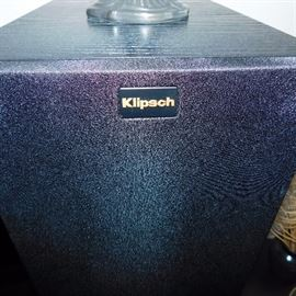 Klipsch surround sound system that consist of two front tower speakers, two surround sound tower speakers, one center speaker and one sub-woofer