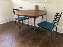 Mid-century dining table - a very special piece indeed.  This petite table was handmade by a WWII veteran and features his hallmark/signature on the underside of the table.  A very classic piece!  An Artemide light from Italy is attached and is sold separately.
