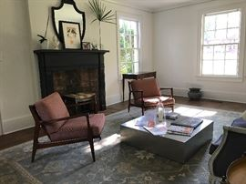 A pair of Ib Kofod Larsen armchairs, made by Selig.  Beautiful French-style canapé from Ashley Gilbreath's shop Parish.  Note the handsome Hepplewhite writing table in the background and the French jardinière under the window at right.  Sadly the Oushak rug is not for sale as it conveys to new owner of home - the coffee table is also not for sale.