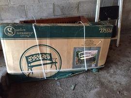 New in box garden bench.