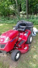 Riding Toro Lawn Mower with bagger.