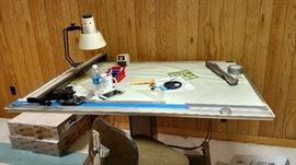 Electric Drafting table that raises tilts.