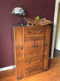 Antique dresser  with several unique drawer combinations.