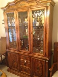 Matching china cabinet filled with treasures