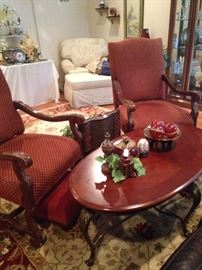 Two arm chairs; oval coffee table matches the two end tables.