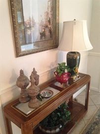 Sofa table filled with decor matches the end tables