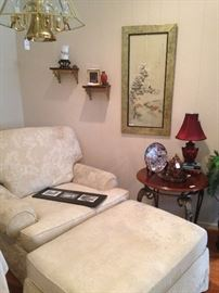Club chair with ottoman and other decor