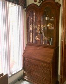 Secretary with lighted-curio top by Jasper Cabinet Co.