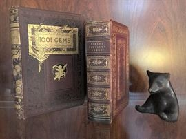 Antiquarian leather bound books, metal fighting bear