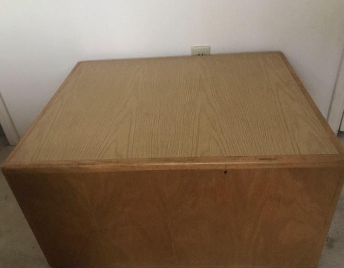 Interesting vintage oak coffee table with hidden storage underneath.