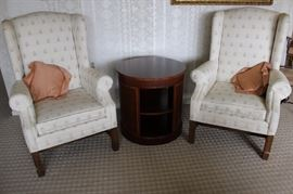 matcjinh armchairs and round two tiered end table.