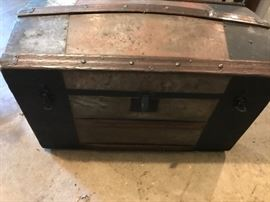 Old bubble trunk with tray and original wallpaper inside