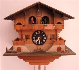 Antique cuckoo clock.  There's many clocks at this sale