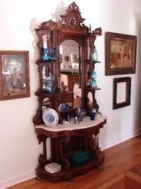 Antique Etagere with marble top in excellent condition.  Antique depression glass, smalls.
