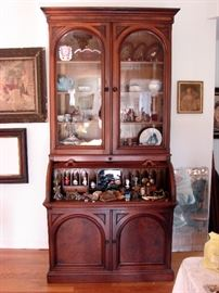 Antique rolltop desk secretary with gingerbread cubbies.  Lots of antique glassware and smalls.